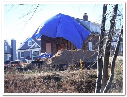 A tarp now covers the damaged part of the Vanderbeck House in Fair Lawn. The side wall of the home partially collapsed after an addition was removed from the house.