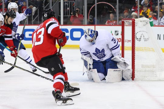 Toronto Maple Leafs goaltender Frederik Andersen (31) makes a save on New Jersey Devils left wing Brett Seney (43) during the second period at Prudential Center.