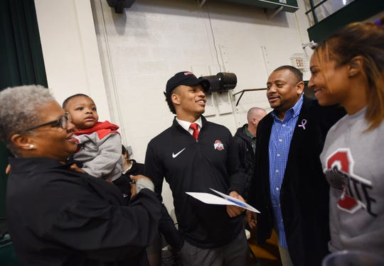 "Ronnie ""Rocket"" Hickman (L), who will be joined Ohio State University football team, talks with his parents Ronnie Hickman Sr., Hanifah Crawley (mother, L), with his nephew Noble Young (age 2) as his niece Tahjanae Johnson(R) looks on prior to the signing day at DePaul Catholic High School in Wayne on 12/19/18."