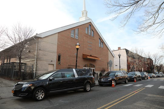 Four hearses parked in front of St.John's Baptist Church on December 19, 2018 in Jersey City, NJ. They are waiting for the afternoon Mass for four children killed in a car accident this month in South Carolina. A father of two of the children is facing four counts of felony DUI resulting in death.