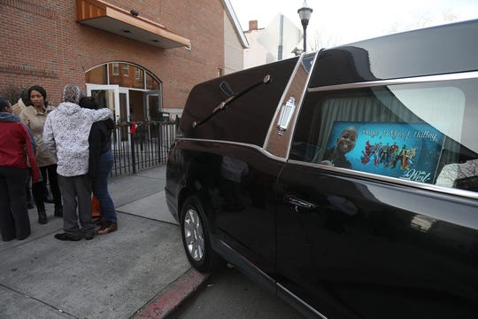 The hearse that will carry the body of Ja'Mire Halley is in front of St. John's Baptist Church on December 19, 2018 in Jersey City, NJ. This is the afternoon Mass for four children killed in a car accident this month in South Carolina. A father of two of the children is facing four counts of felony DUI resulting in death.