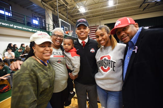 "Ronnie ""Rocket"" Hickman (L), who will be joined Ohio State University football team, has photos taken with (L to R), Kiyata Brooking (aunt), Hanifah Crawley (mother) with his nephew Noble Young (age 2), Tahjanae Johnson (niece ) and his father Ronnie Hickman Sr., following the signing day at DePaul Catholic High School in Wayne on 12/19/18."