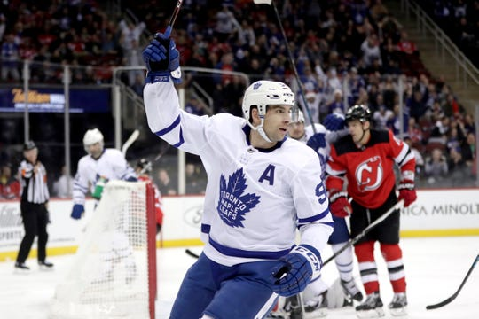 Toronto Maple Leafs center John Tavares celebrates his first period goal against the New Jersey Devils during an NHL hockey game, Tuesday, Dec. 18, 2018, in Newark, N.J.