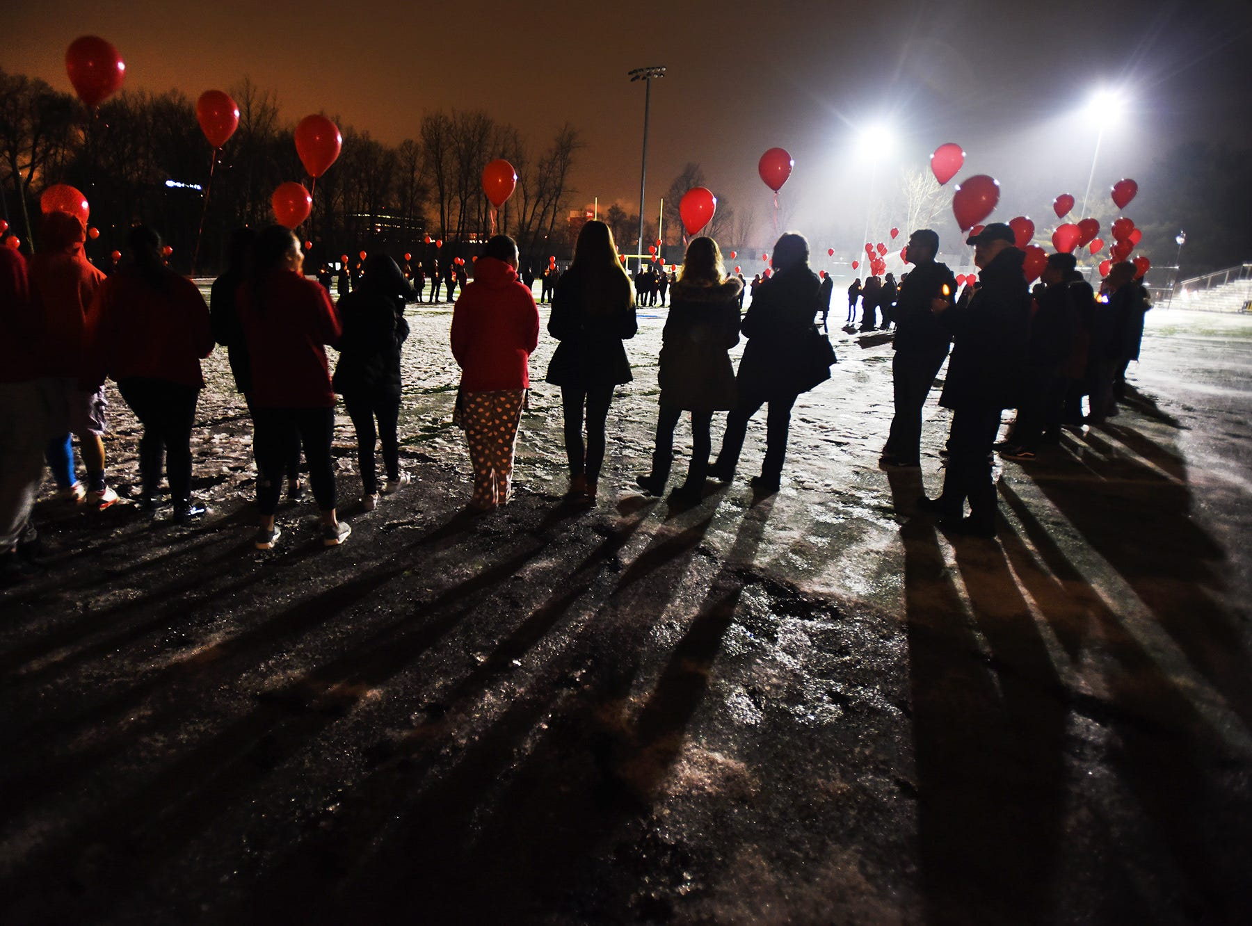 """Participates gather with red balloons during a  """"Community Remembrance Vigil"""" for Saddle Brook High School student Andrew Gutierrez at Veteran's Field in Saddle Brook on 02/19/18.  Andrew Gutierrez, a SBHS 10th grader, suddenly and unexpectedly passed away at home on Friday, February 16th."""