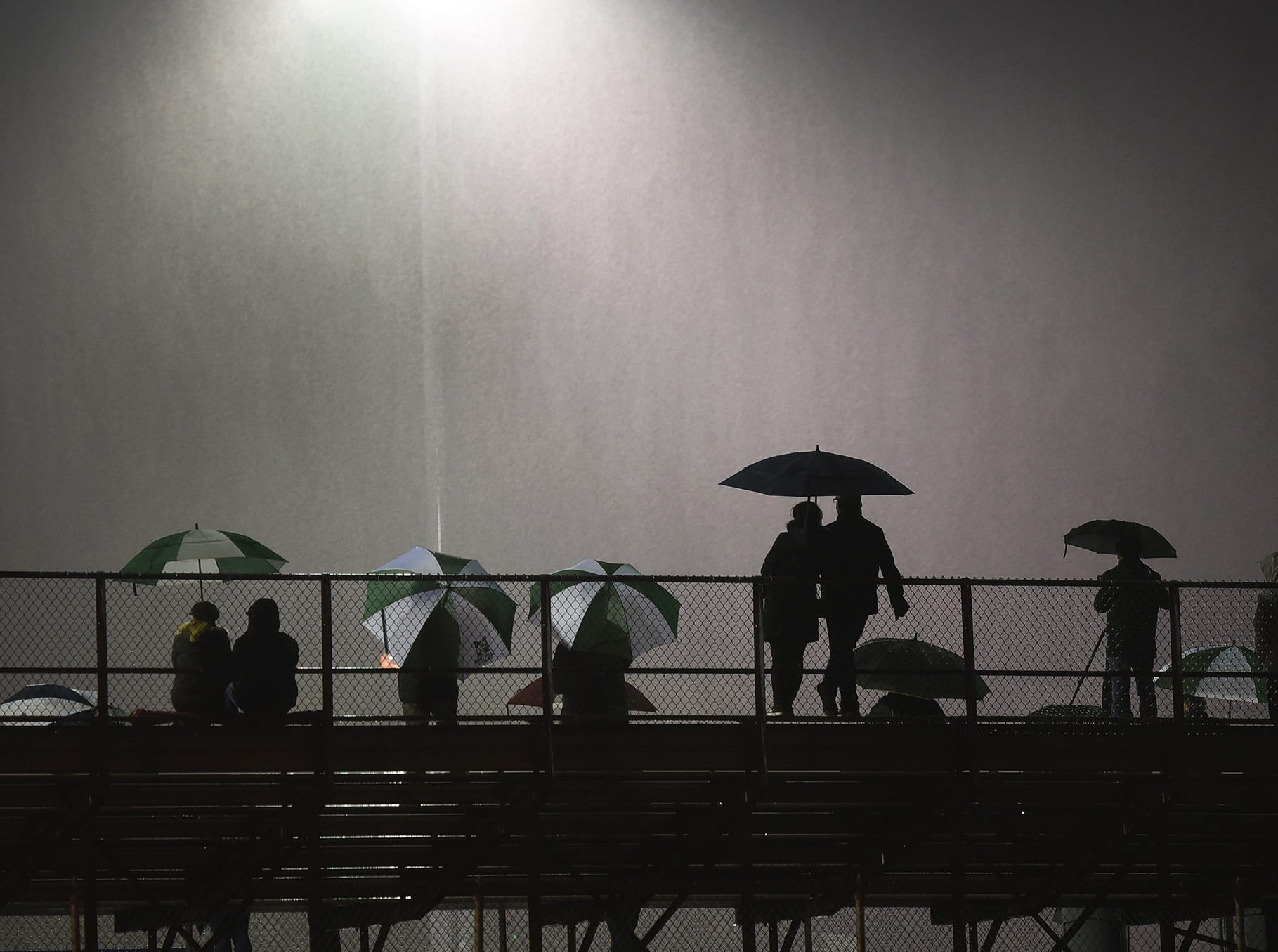 As the rain continues to fall, parents and friends on the bleachers, watch a boys soccer game of Paramus against Montville in the first half during the NJSIAA North 1 Group III semifinal at Paramus High School on 11/5/18.