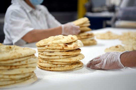 The seven-inch gyro breads are stacked for bagging at the Kontos Foods factory on Thursday, Dec. 13, 2018, in Paterson.