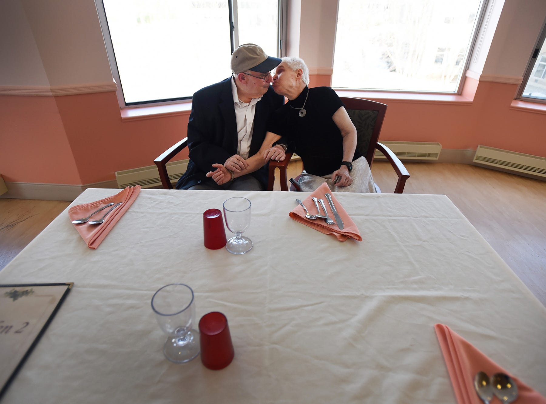 Charlotte Poole (age 69) and her fiance Michael Frederick Shapiro (age 73), reunited lovers who became engaged at the Rockleigh Home earlier this month, kiss each other, photographed at Jewish Home at Rockleigh in Rockleigh on 02/08/18.