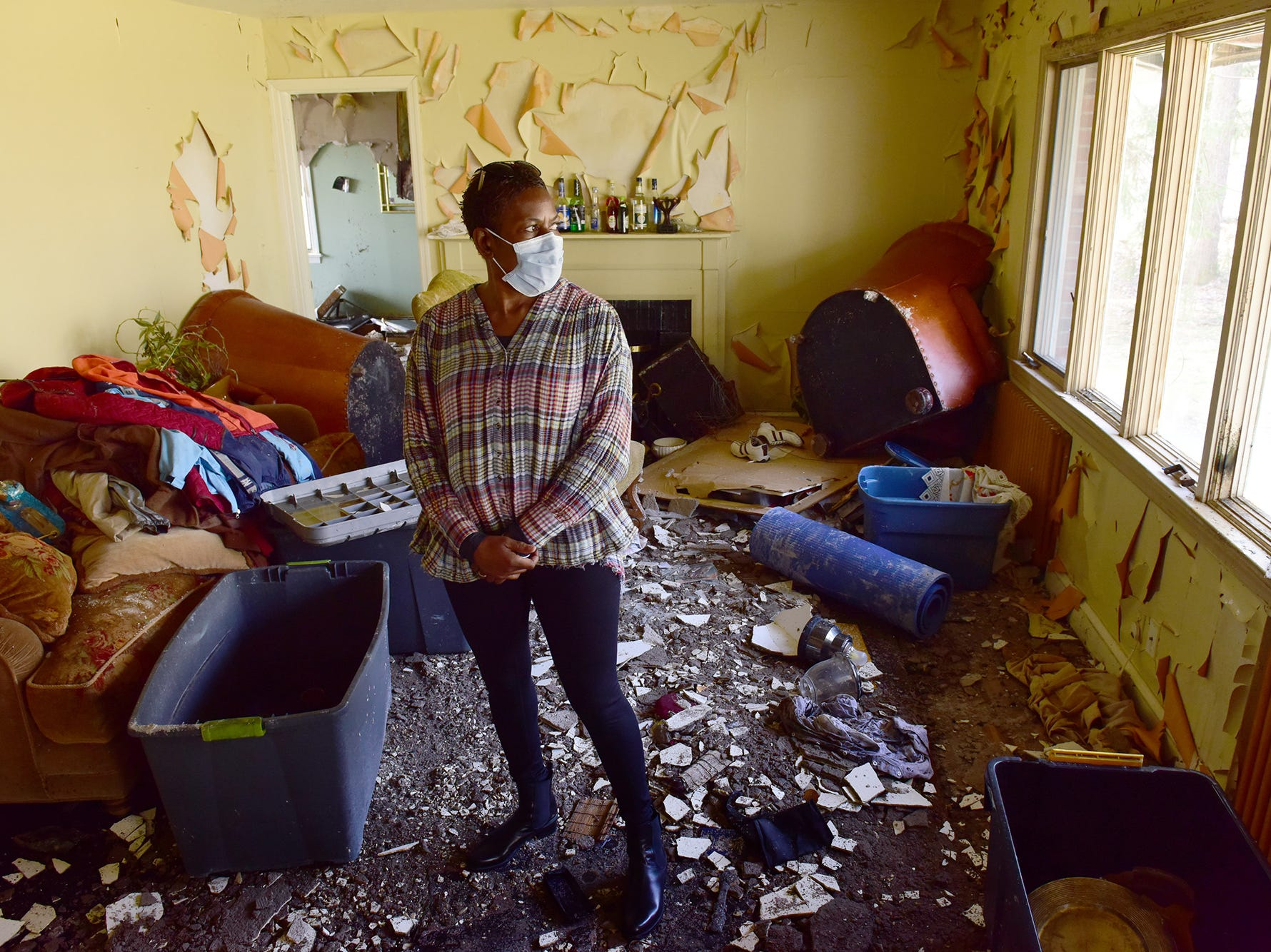 Betty Adams walks out of her burned out home in Hawthorne Wednesday morning September 27, 2017. The early morning fire destroyed her a home on Sunrise Dr. in Hawthorne, on Monday morning on September 24, 2018.