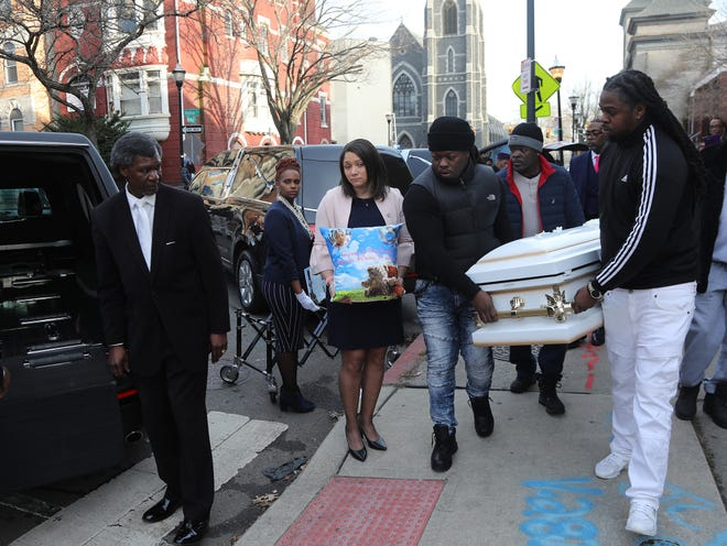 The casket of Ar' Mani Jamison is being put into a hearse in front of St. John's Baptist Church on December 19, 2018 in Jersey City, NJ. The afternoon funeral Mass was for four children killed in a car accident this month in South Carolina. A father of two of the children is facing four counts of felony DUI resulting in death.