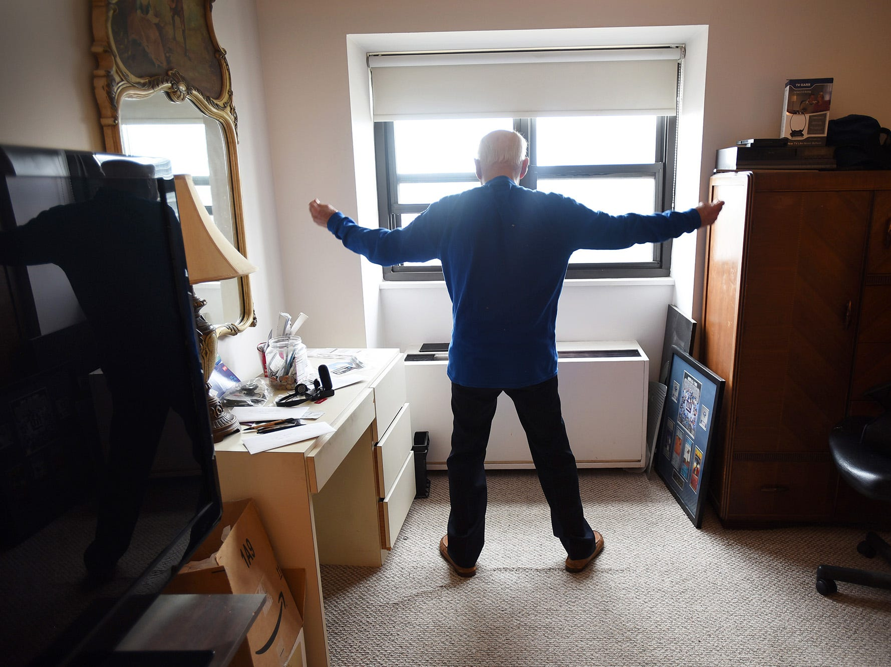 Sidney Gottlieb (age 92) of Cliffside Park, who has set a record in the Senior Olympics, exercises as he looks outside from his home in Cliffside Park on 06/13/18. Sidney runs, does 100 situps every day, pushups,etc lifts weights. He considers himself a role model for other seniors to stay active.