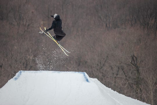 A skier enjoys opening day at Mountain Creek.