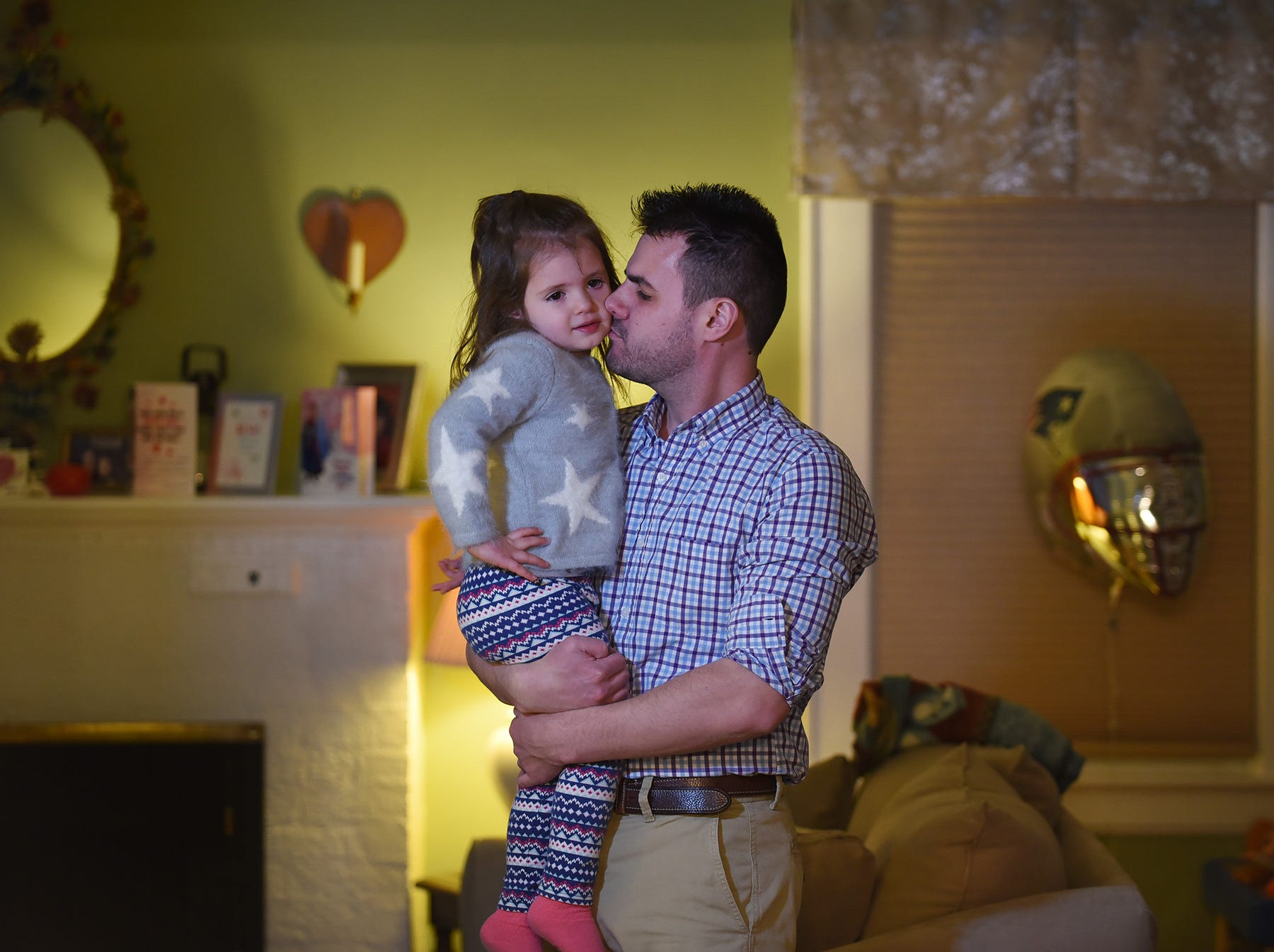 Photo of Jim Villanella (37) and her 2-year-old daughter Isabelle, at their home in Verona on 02/26/18. March 3rd will mark one year since the death of Megan Villanella in Verona. Megan was hit by a car while standing on the sidewalk on Lakeside Avenue in Verona. She was about seven months pregnant at the time.