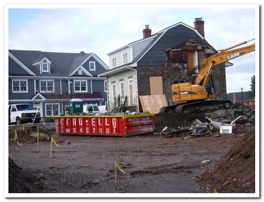 A developer agreed to keep an historic house on site of a new 55-and-over townhouse development. One wall of the house partially collapsed after construction.
