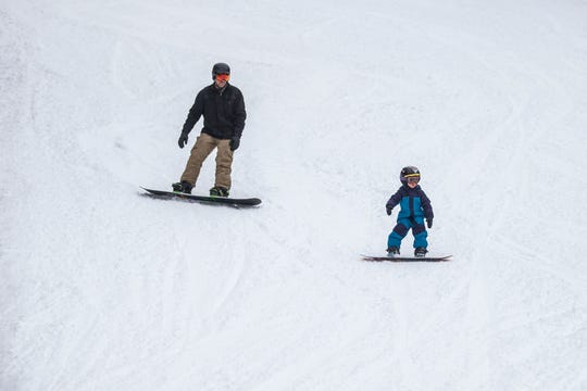 Snowboarders enjoy opening day at Mountain Creek.