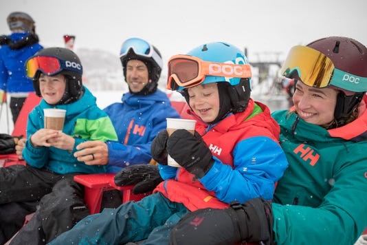 Family Skiing Ridding