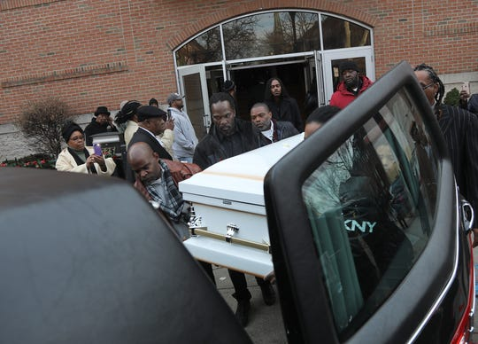The casket of Robbiana Evans is being put into a hearse in front of St. John's Baptist Church on December 19, 2018 in Jersey City, NJ. The afternoon funeral Mass was for four children killed in a car accident this month in South Carolina. A father of two of the children is facing four counts of felony DUI resulting in death.