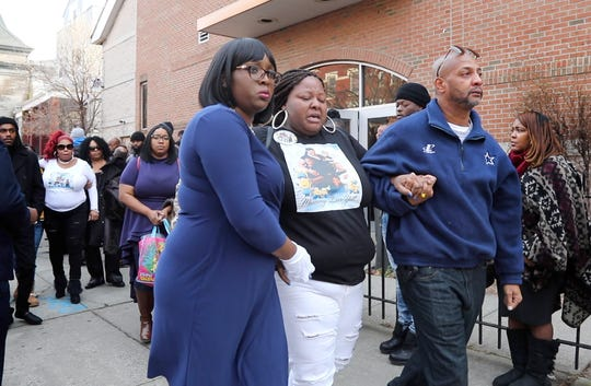 Jaqueline Brown, center, the mother of two of the children who died in the car accident, is taken from of St.John's Baptist Church on December 19, 2018 in Jersey City, NJ. She exited the afternoon Mass for four children, killed in a car accident this month in South Carolina. A father of two of the children is facing four counts of felony DUI resulting in death.