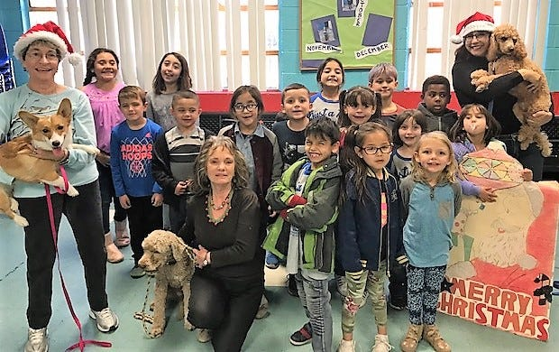 """Pictured withe the children are Critter Connection humane educators Susan Sammis, left, with """"Bou"""" and """"Leo"""" and Jean Gilbert, center, and Rose Street, right, with """"Lucas."""""""
