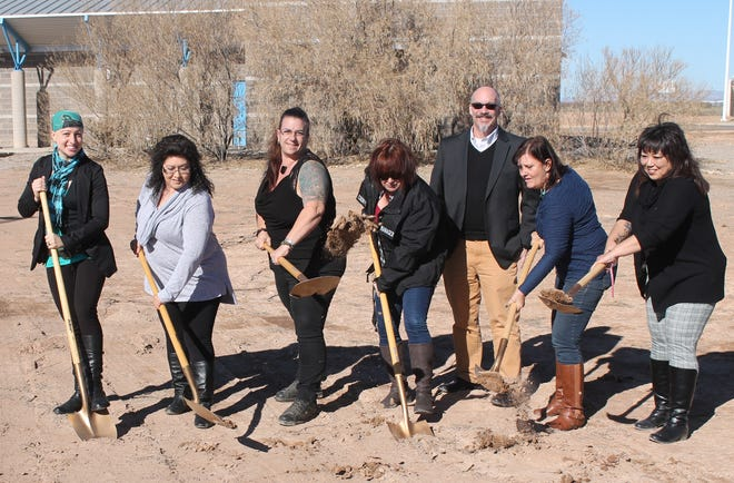 From left: Donna Marion of Studio Southwest Architects, Otero County Correction Services Director Carolyn Barela, Otero County Commission Chairwoman Lori Bies, Otero County Manager Pamela Heltner, Andy Benson of Studio Southwest Architects, Otero County Commissioner Susan Flores and Otero County Correction Services Deputy Director Nena Sisler break ground at the Otero County Detention Center expansion Wednesday afternoon.