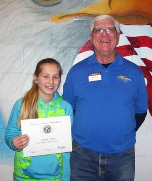 Holloman Middle School seventh grader Hanna Yelton, and Ned Kline of Kiwanis Club.  Not available for picture were sixth grader Jailen Anderson and eighth grader Jalen Coley.