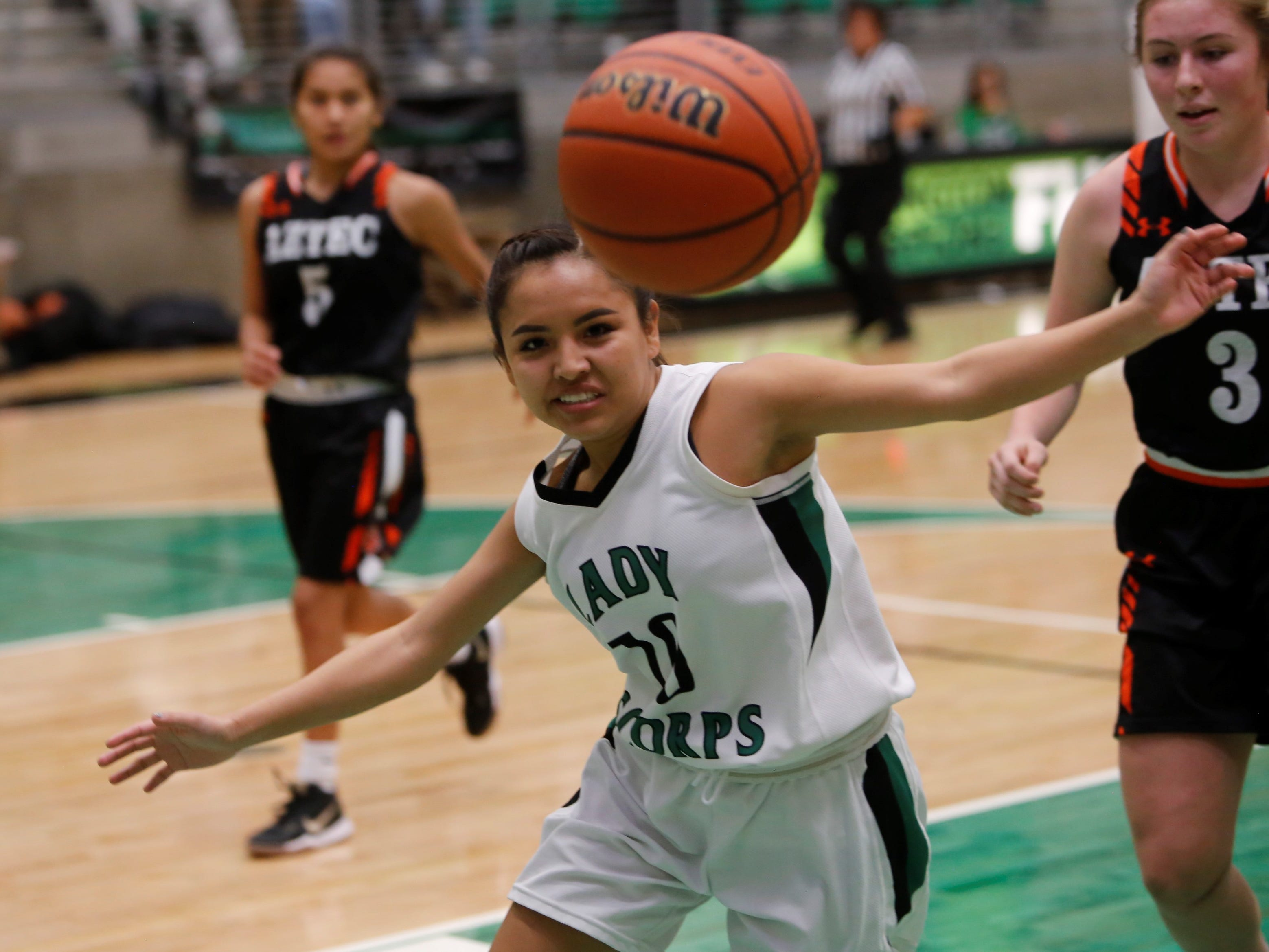 Farmington's Natiana Arviso watches the ball fly out of bounds against Aztec during Tuesday's game at Scorpion Arena.