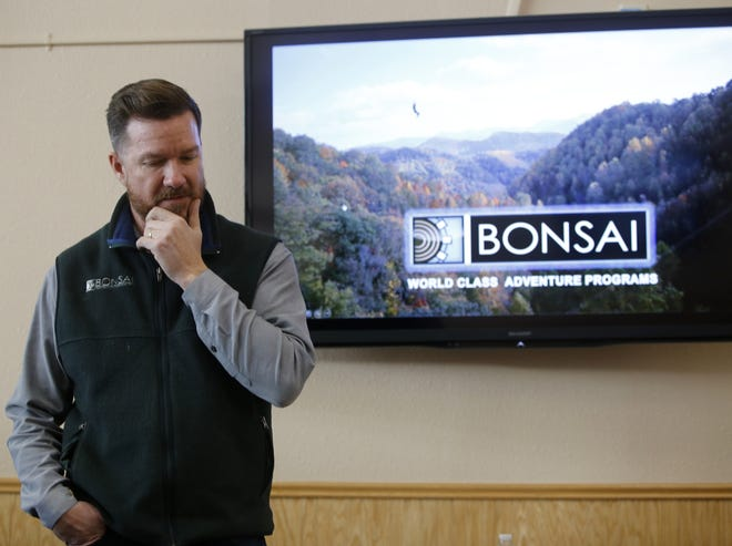 Thaddeus Shrader, CEO of Bonsai Design, addresses the crowd Tuesday during a community input meeting in Farmington on the city's plans to construct aerial adventure parks.