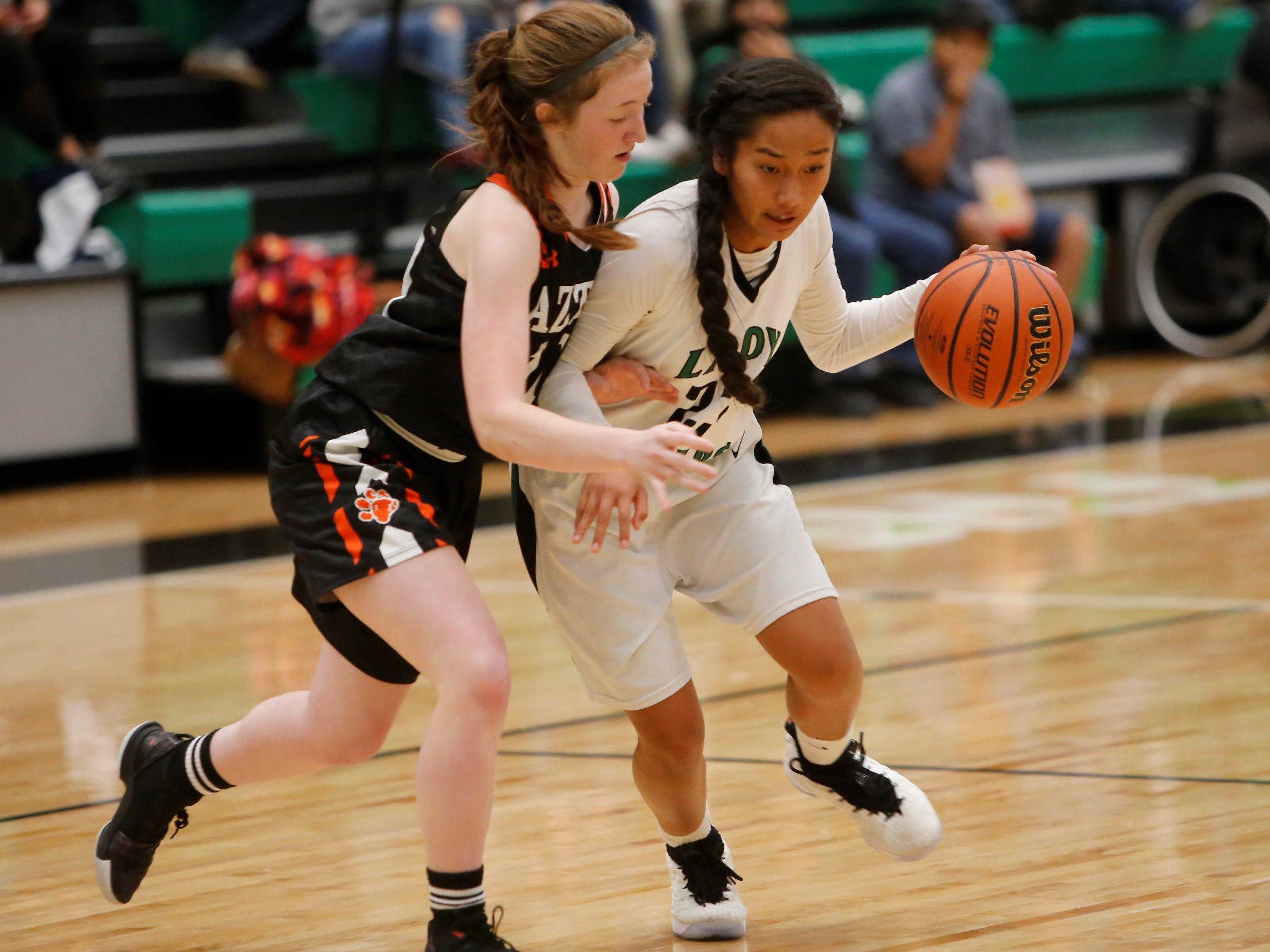 Farmington's Kiiyani Anitielu attacks the basket against Aztec's Aztec's Jessi Gillentine during Tuesday's game at Scorpion Arena.