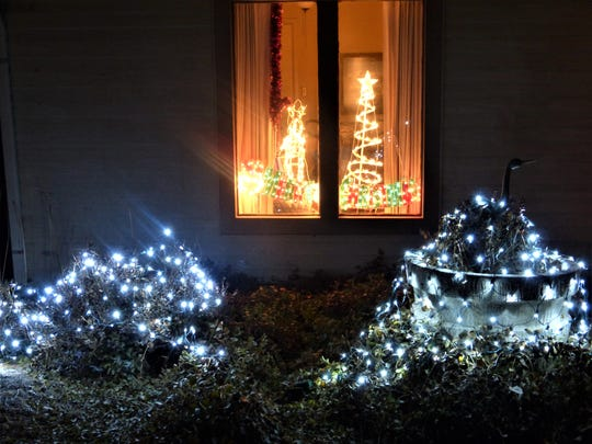 Merry Christmas with lights inside and outside.