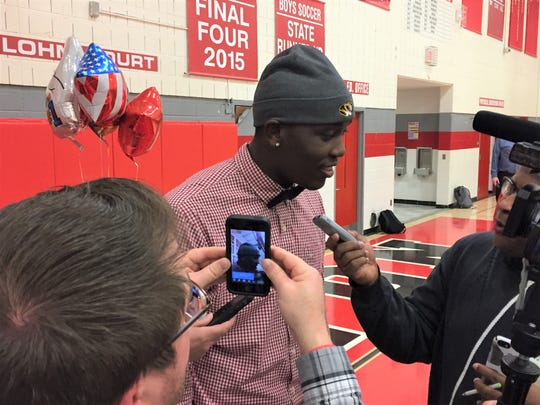 Canton's Darius Robinson is surrounded by reporters after announcing he had signed with the University of Missouri to play football.
