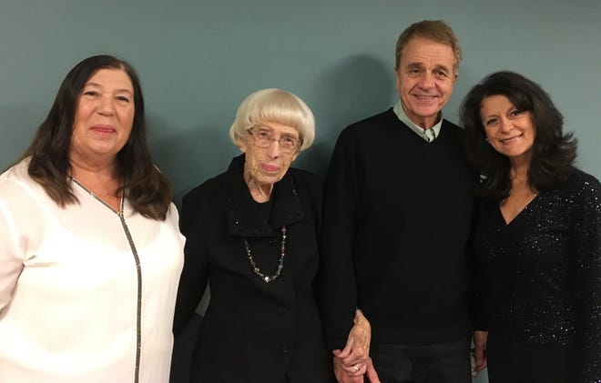 Family members gathered  to celebrate the 101st birthday of  community volunteer Virginia Smith. (From left) Barbara Erickson, who came from Minnesota; Virginia Smith; Smith's son, Dr. Roger Smith, and daughter-in-law Susan Kheder Smith.
