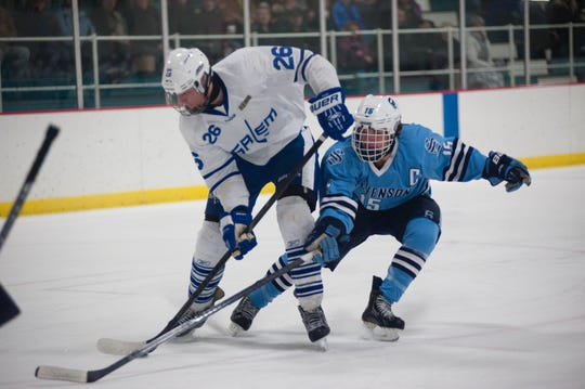 Current Ferris State hockey player Dominic Lutz (at right in this 2014 file photo) is shown during his Livonia Stevenson career vying for a loose puck with Salem's Jason Newel -- who went on to play for the Metro Jets after high school.