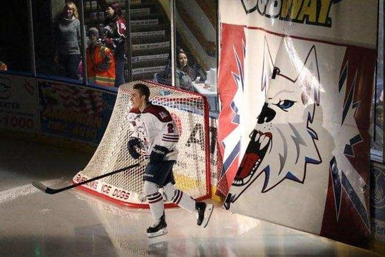 Drew Garby skates through the Fairbanks Ice Dogs tunnel at the beginning of a recent NAHL game. He is a 2018 grad of Plymouth High School.