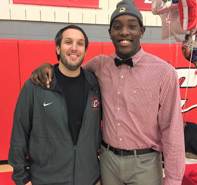 Missouri signee Darius Robinson (right) with Canton head football coach Andrew LaFata after signing his National Letter of Intent on Wednesday.