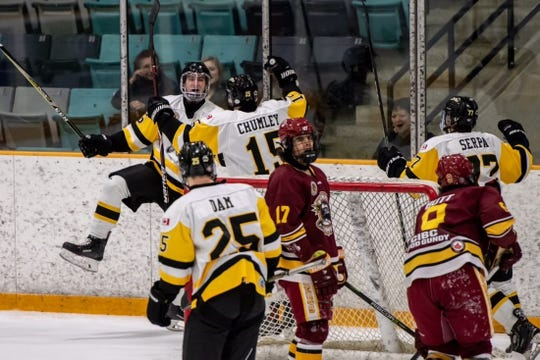 Jack Chumley (15), a 2018 Plymouth grad, gets in on a goal celebration with Waterloo Siskin teammates.