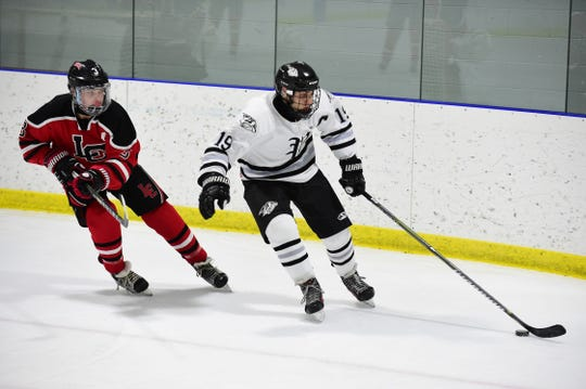 This year, Jack Chumley is playing junior hockey in Canada. But last year, he was in KLAA action with the Plymouth Wildcats. Here, Chumley (19) is shown carrying the puck against Livonia Churchill's Carter Swider.