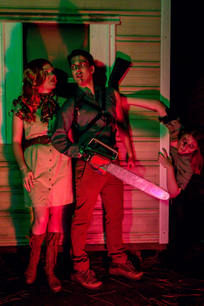 """Evil Dead: The Musical"" cast members Hannah Sharpe, left, Garrett Summitt, and Kay Joyce pose for a promo photo on Wednesday, Dec. 12, 2018. The musical, based off of three ""Evil Dead"" movies between 1981 and 1992, runs from Jan. 3 through Jan. 6, at Vinyl Music Hall."