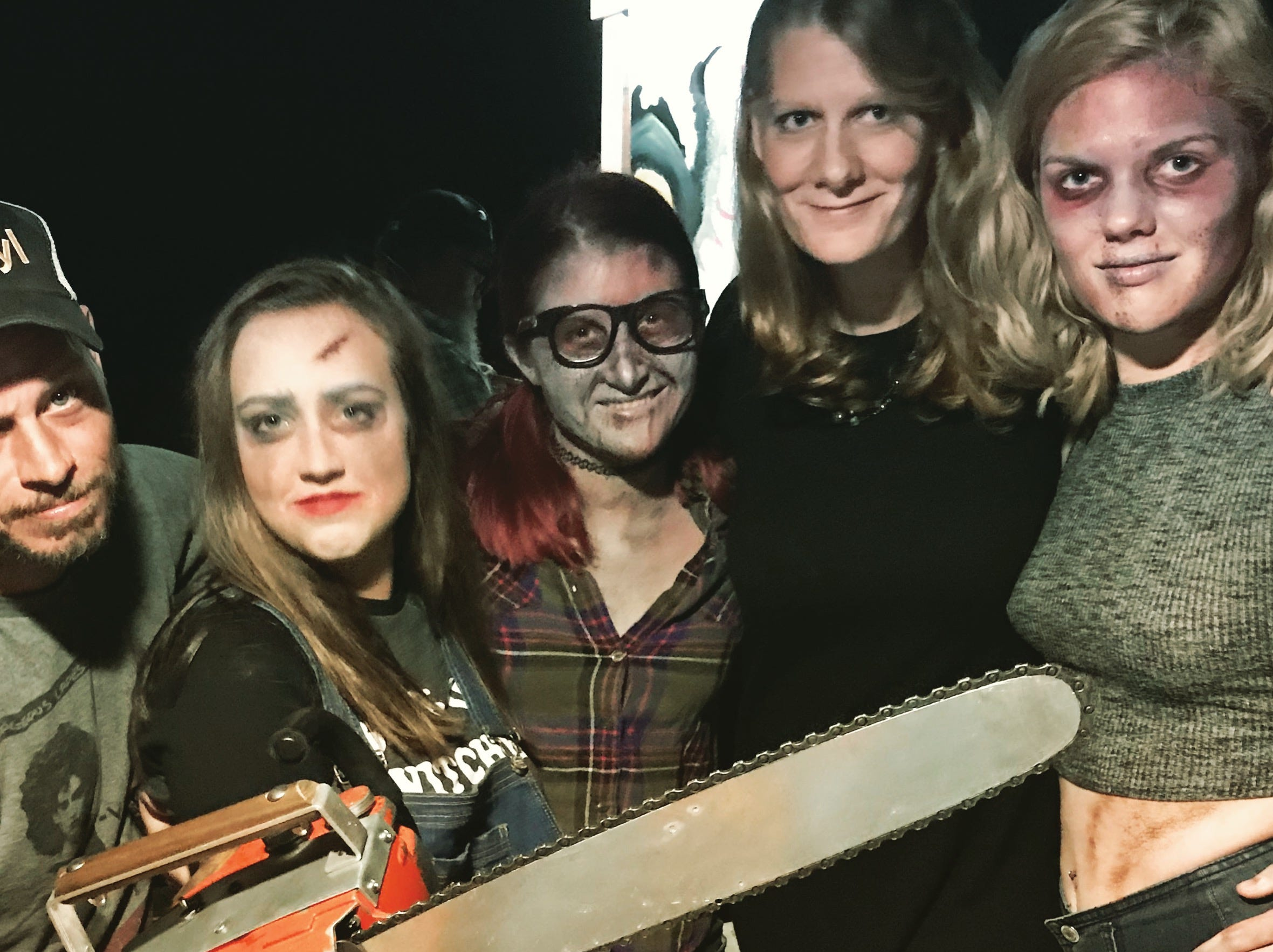 "Co-directors Chris Wilkes, left, and Nicole Dickson, second from right, gathered cast and crew for ""The Evil Dead: The Musical"" from throughout Pensacola's theater community, including Sierra Hobbs as Linda, Kay Joyce as Cheryl and Hannah Sharpe as Shelly."