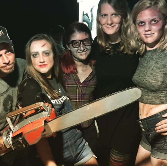 """Co-directors Chris Wilkes, left, and Nicole Dickson, second from right, gathered cast and crew for """"The Evil Dead: The Musical"""" from throughout Pensacola's theater community, including Sierra Hobbs as Linda, Kay Joyce as Cheryl and Hannah Sharpe as Shelly."""