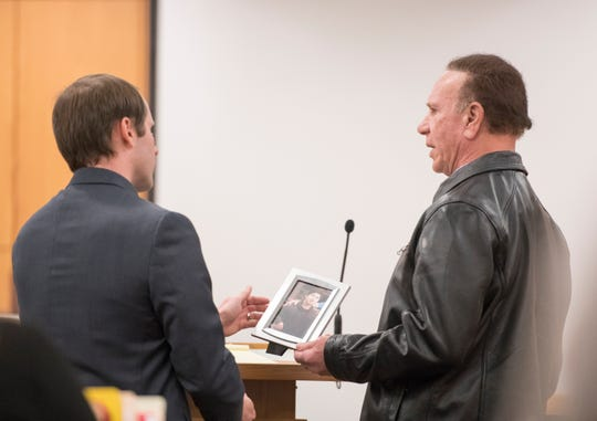 Stanley White, right, shows a photo of his son, John Paul White, during Katy Colvin's sentencing at the Escambia County Courthouse in Pensacola on Wednesday. Colvin was convicted for DUI manslaughter in the death of John Paul White.