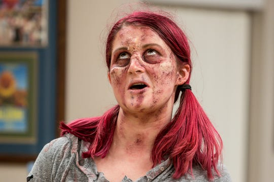 """Kay Joyce, playing Cheryl, runs through a scene during a rehearsal of """"Evil Dead: The Musical"""" on Wednesday, Dec. 12, 2018. The musical, based off of three """"Evil Dead"""" movies between 1981 and 1992, runs from Jan. 3-6 at Vinyl Music Hall."""