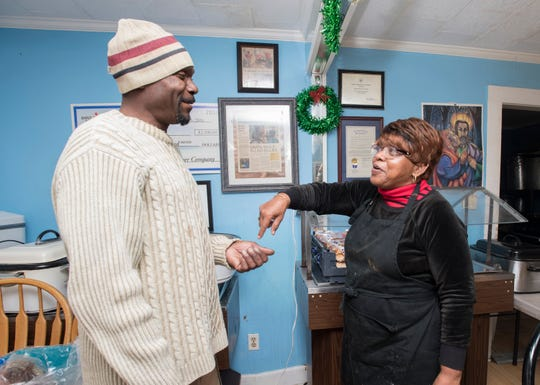 Sylvia Tisdale, right, points out that it is Aaron Miles, one of her success stories, that is featured in a previous PNJ article hanging behind them on the wall at the Epps Christian Center in Pensacola on Wednesday, December 19, 2018.