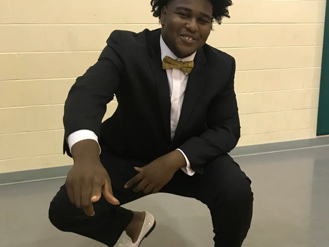 Pensacola High's Adrian Medley celebrates signing with UCF on Wednesday.