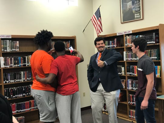 Hunter Rayburn has fun with Pensacola High teammates during his signing event reception Wednesday after signing with Clemson Tigers