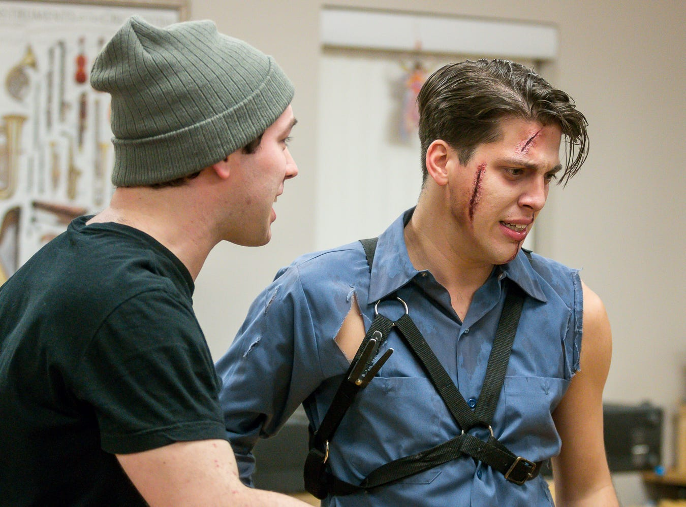"Chris Holloway, playing Scott, left, and Garrett Summitt, playing Ash, run through a scene during a rehearsal of ""Evil Dead: The Musical"" on Wednesday, Dec. 12, 2018. The musical, based off of three ""Evil Dead"" movies between 1981 and 1992, runs from Jan. 3 through Jan. 6, at Vinyl Music Hall."