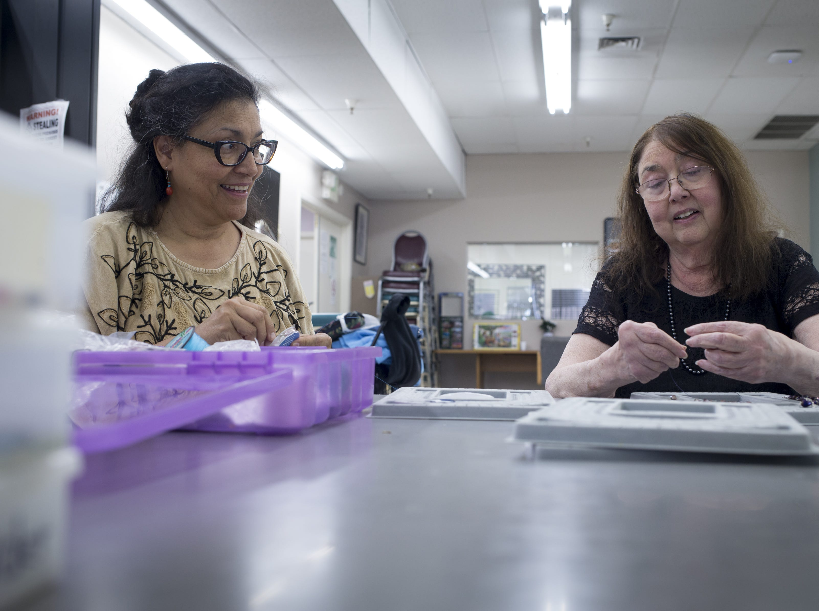 Barbara Cory (right) and Cynthia Fodness make jewelry, Dec. 12, 2018 at Phoenix Senior Opportunities, 1220 S. Seventh Ave. in Phoenix. Cory copes with asthma that can flare up when smog worsens in Phoenix's winter months.