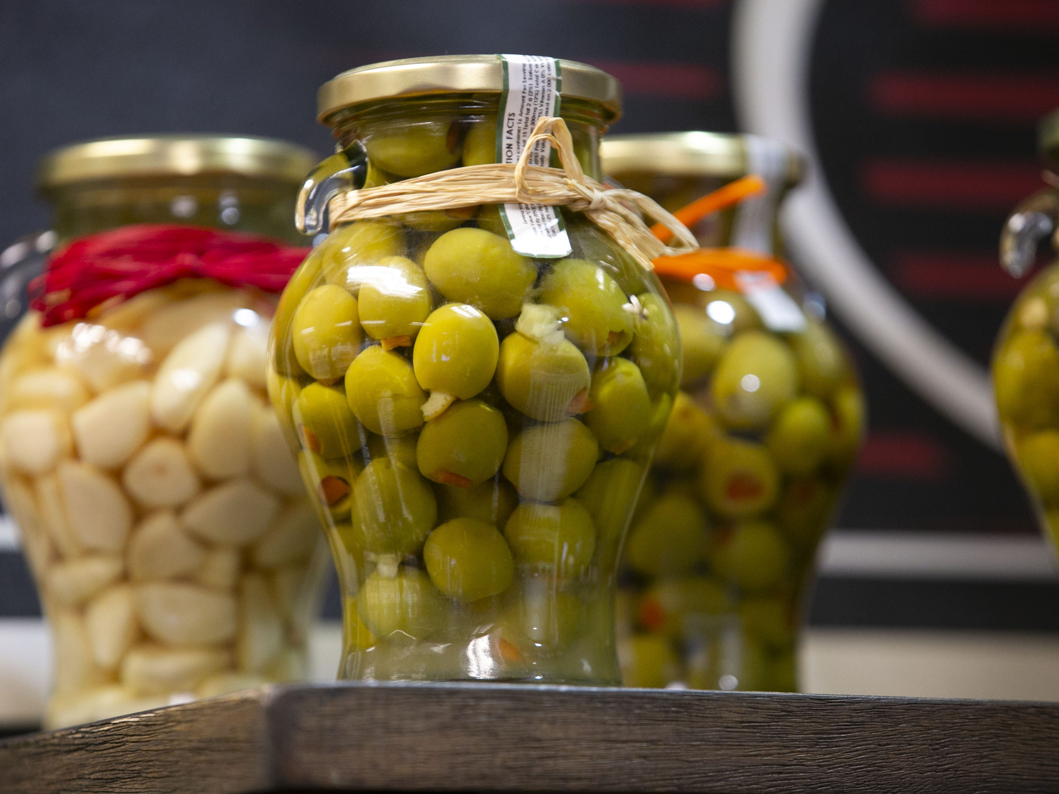 Olives at Outrageous Olive Oils & Vinegars in Old Town Scottsdale on Tuesday, Dec. 11, 2018. The shop is owned by former child actor, Frankie Muniz and his fiance Paige Price.