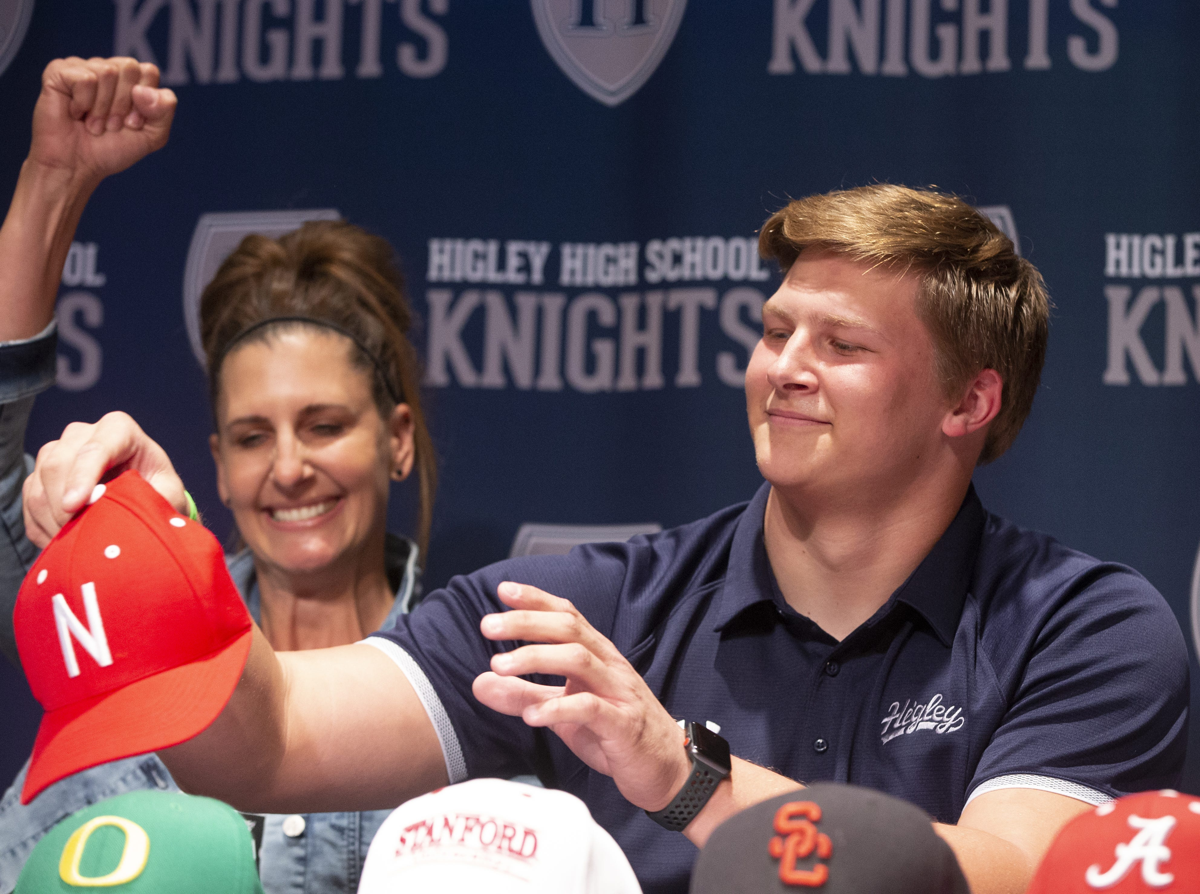 Higley defensive lineman Ty Robinson celebrates with his mom, Tresha, after he announces he will be attending University of Nebraska during signing day at Higley High in Gilbert on December 19, 2018. #hsfb