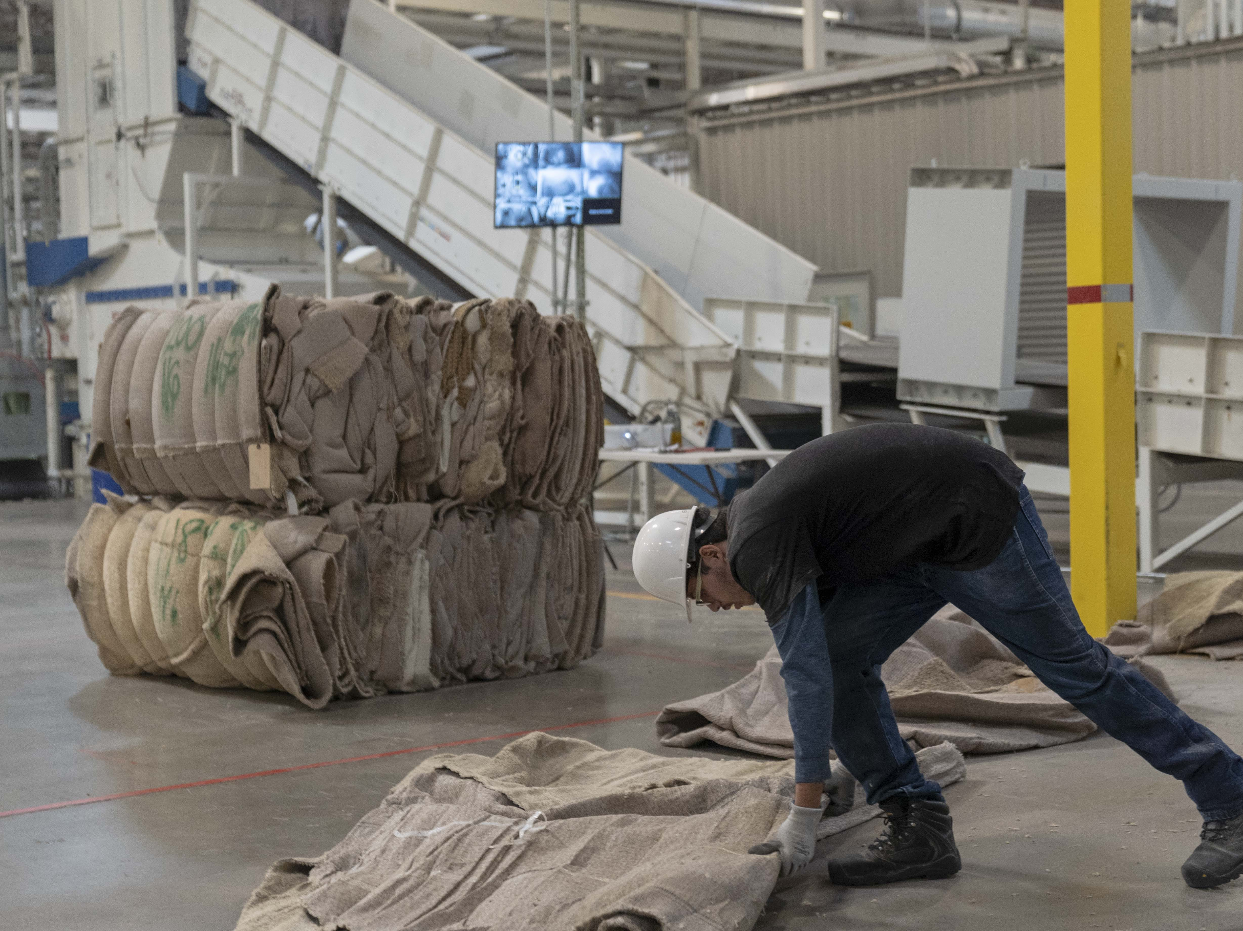 The Aquafil plant shreds, washes and separates materials from carpet remnants and worn carpets.