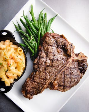 Porterhouse steak, lemon-butter green beans and lobster mac and cheese from Keeler's Neighborhood Steakhouse.