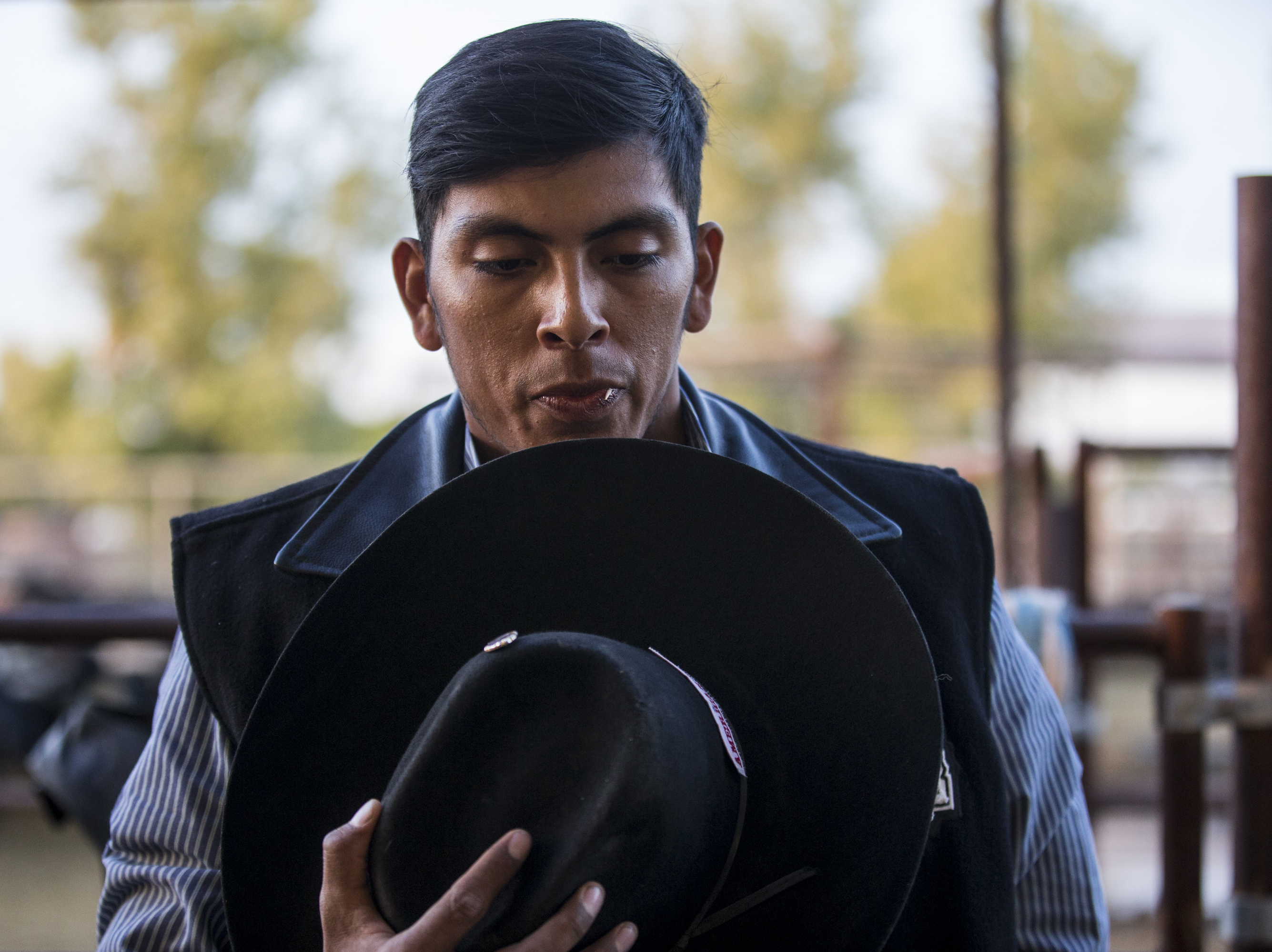 Jalen Joaquin prays during the Gilbert Days Rodeo on Saturday, Nov. 17, 2018, in Gilbert, Ariz.